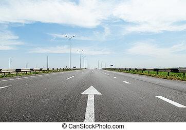 white arrow on asphalt road