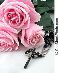 rosary and roses - a rosary cross surrounded by pink roses
