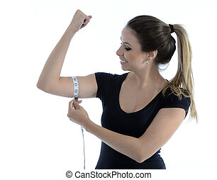Fitness girl measuring her biceps - Pretty beautiful girl...