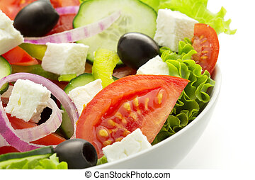 fresh greek salad - close up of a fresh vegetable salad