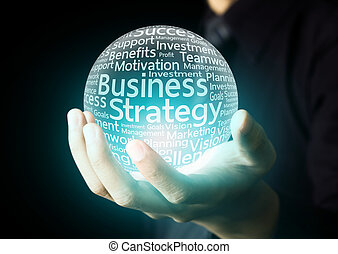 Business strategy word in ball - Businessman hand showing...