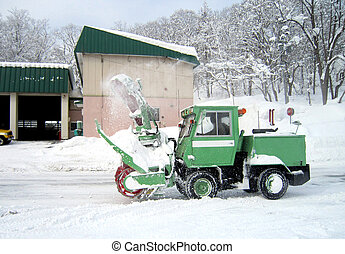 green snow truck on snowy road