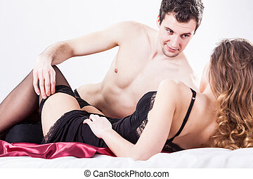Erotic situation in bedroom - Horizontal view of an erotic...