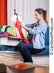 Woman packing her clothes - Beautiful woman packing her...
