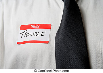 My Name is Trouble - A name tag the reads, Hello My Name is...