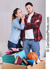 Young attractive couple during the moving house portrait