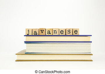 javanese language word on wood stamps and books - javanese...