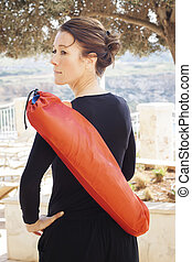 Middle aged woman with yoga mat - Senior yoga instructor...