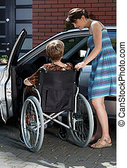 Disabled and daughter next to car - Disabled lady and her...