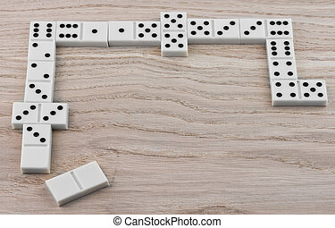 dominoes playing - top view of dominoes playing on wooden...