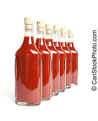 Red hot sauce - Bottles with red hot chili sauce in a row on...