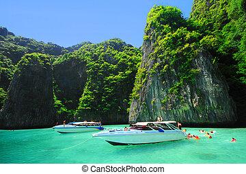 Boats and the clear sea at Phi Phi Leh island, Andaman sea...