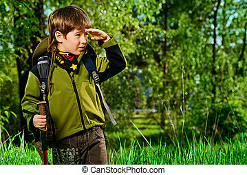 adventure - Portrait of a cute 7 years old boy in tourist...