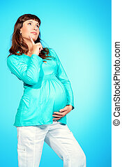 ponder - Beautiful pregnant woman ponders something. Family,...