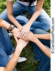 teamwork - hands together to build a team