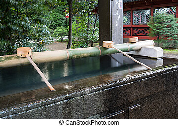 TOKYO - CIRCA JUNE 2014: Cleansing basin in Shinto temple....