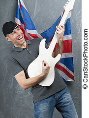 Smiling man in gray against background of the British flag...