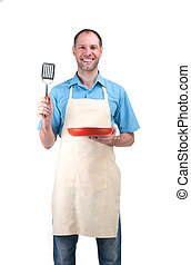 Handsome man holding a dish and a blade
