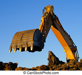 Shovel bucket against blue sky - Hydraulic excavator at work...