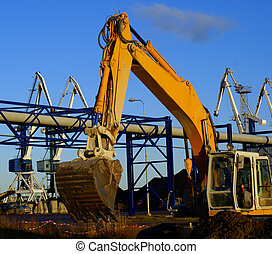 Hydraulic excavator at work Shovel bucket against blue sky -...