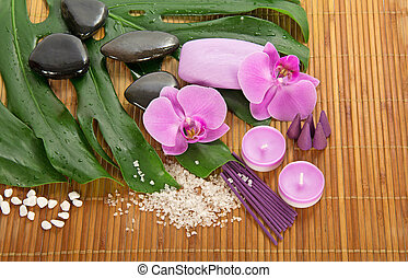 Monstera leaf, orchid and set for Spa
