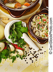 Fresh Herbs - Table setting of freshly baked beef stew with...