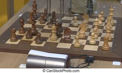 The game of chess - The robot plays chess with the person