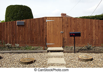 Gate - A new wooden fence with a path leading to the gate