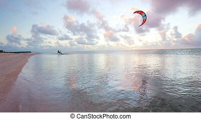 kiteboarding at sunset - kite surfing at sunset fun in the...