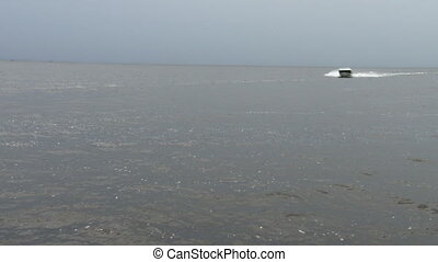 Boat navigating fast on a lake - Small boat navigating fast...