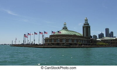 Navy pier in Chicago seen from a boat navigating on lake...