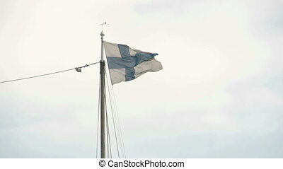 A Finland flag waving on the breeze of the wind FS700...