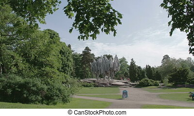 A park from Helsinki Finland with a monument - A park with a...