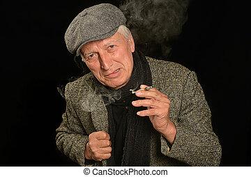 man smoking cigarette - Smiling Senior man smoking cigarette...