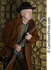 Mature male Bandit with gun in the wild west
