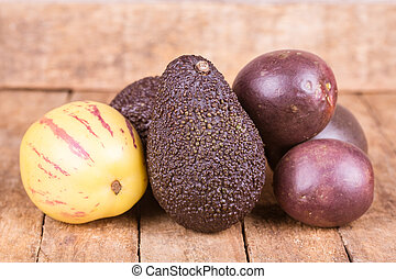 healthy fruits - fresh healthy fruits on a wooden background...