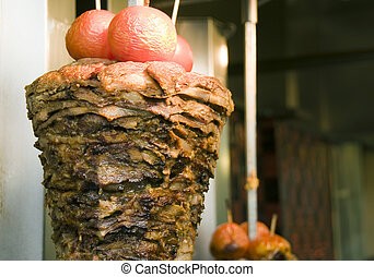 authentic greek gyro athens greece - meat cooking on skewer...