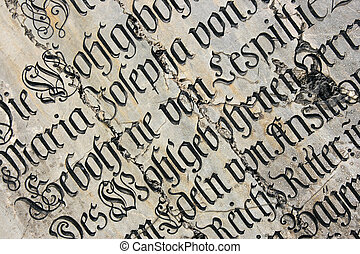 Tomb text - Vintage gothic script on a tomb. Mariendom...
