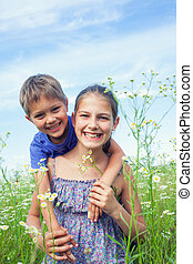 Kids with wild spring flowers