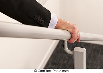 Hold the handrail - close upwith selective focus of a...