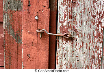 Cast Iron Hook and Eye Lock on Old Barn Door - Close up on...
