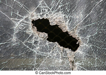 Broken window of armoured glass. Bulletproof glass hole.