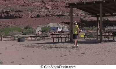 Tourist Along Colorado River - a senior tourist admires the...