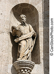 Saint Paul sculpture in Valladolid cathedral facade. Old...
