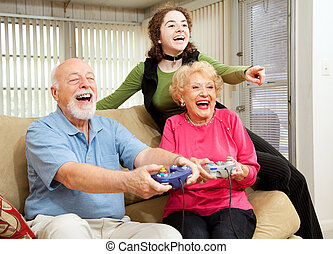 Family Fun - Grandparents and teen girl having fun playing...