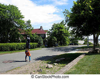 Man Handstands on road in Gloucester, Massachusetts