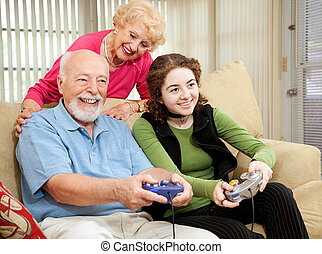 Family Time with Grandparents - Senior couple has fun...