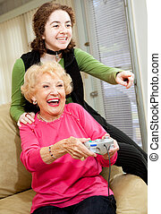 Grandma Loves Video Games - Grandmother and teen...