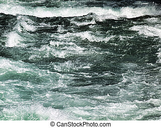 Stormy river - Powerful river stream just after snow melting...