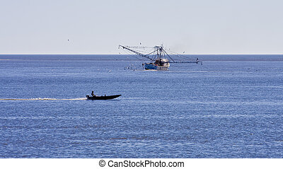 Fishing Boat Past Shrimp Boat - A fishing boat cruising past...